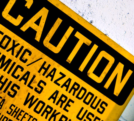 Caution toxic materials sign